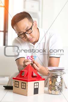 asian male worried about property taxes