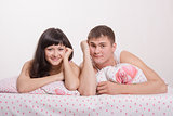 Happy young couple in bed smiling faces