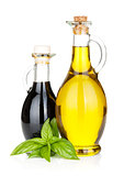 Olive oil and vinegar bottles with basil