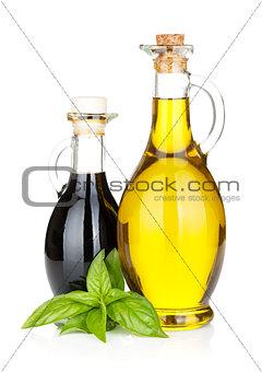 Olive oil and vinegar bottles with basil