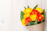 Colorful tulips over wooden table