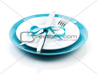 Fork with knife over blank plates