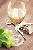 White wine glass and grapes