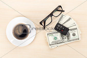 Money cash, glasses, car remote and coffee cup