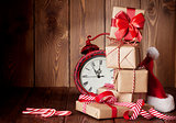 Christmas gift boxes, alarm clock and santa hat