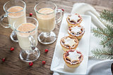 Glasses of eggnog with mince pies
