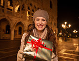 Woman showing Christmas gift box on Piazza San Marco, Venice