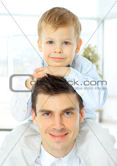 portrait of the father  holding his son