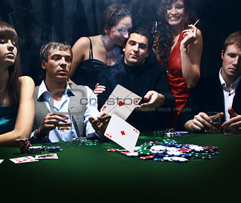 young people are playing poker in a casino
