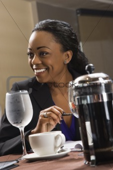 Businesswoman at table.