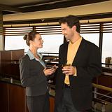 Man and woman drinking at bar.