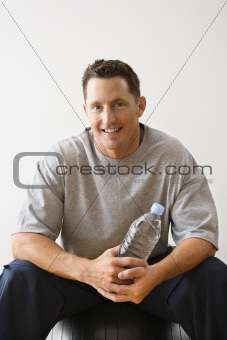 Man holding water bottle