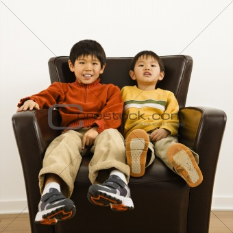 Asian brothers in chair