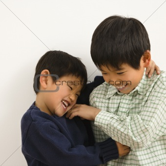 Asian brothers playing