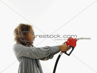 Angry woman with gas nozzle