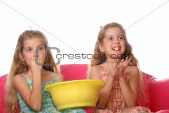 shot of children watching a movie laughing & eating popcorn