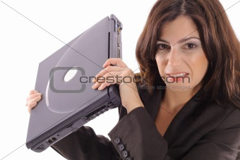 shot of a angry woman with laptop