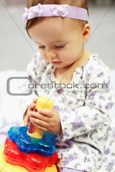 Cute baby plays with toy