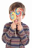 Child eating two lollipops