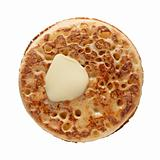 buttered crumpet, shot from the top, isolated