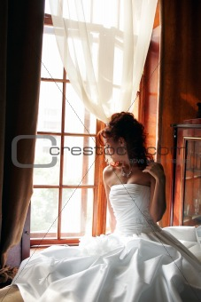 Bride in hotel bedroom