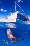 A adventurous woman swimming with sharks