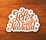 Feliz navidad hand lettering sticker on wood