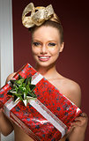 happy creative woman with christmas gift