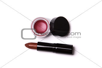 Golden red lipstick and lip gloss in jar