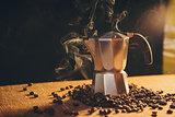 Italian coffee maker and coffee beans