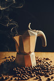 Old Italian coffee maker with coffee beans