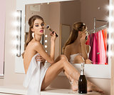 woman doing make-up in changing room