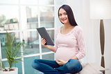Young pregnant woman at home