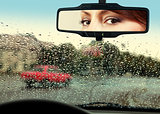 driver looks to rearview mirror