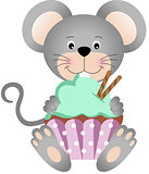 Mouse eating cupcake