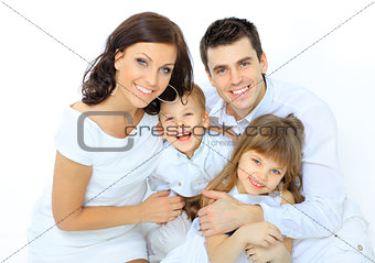 boy laughs with family
