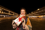 Woman with Christmas gift box on Piazza San Marco, Venice