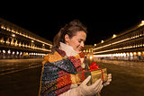 Woman looking on Christmas gift box on Piazza San Marco, Venice