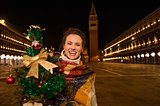 Woman with Christmas tree standing on Piazza San Marco in Venice