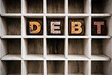 Debt Concept Wooden Letterpress Type in Draw