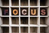 Focus Concept Wooden Letterpress Type in Draw
