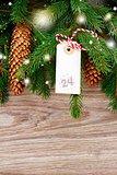 fir  tree with merry christmas tag for 24 december