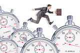 Businessman running with set of timers