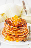 A Stack of Pumpkin Pancakes Topped with Pumpkin-in-Syrup Preserv