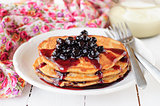 A Stack of Pumpkin Pancakes Topped with Chokeberry Preserves, co