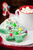 Christmas Tree Cookies on a White Plate with a Cup of Coffee or