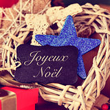 ornaments and text joyeux noel, merry christmas in french