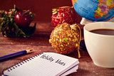 christmas ornaments, cup of coffee, globe and text holidays blue