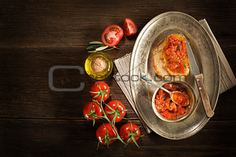 Appetizer with tomato sauce and bruscetta.