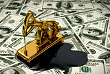 Golden Pumpjack And Spilled Oil On The Money